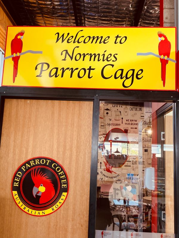 Norm the Red Parrot Coffee mascot welcomes you!