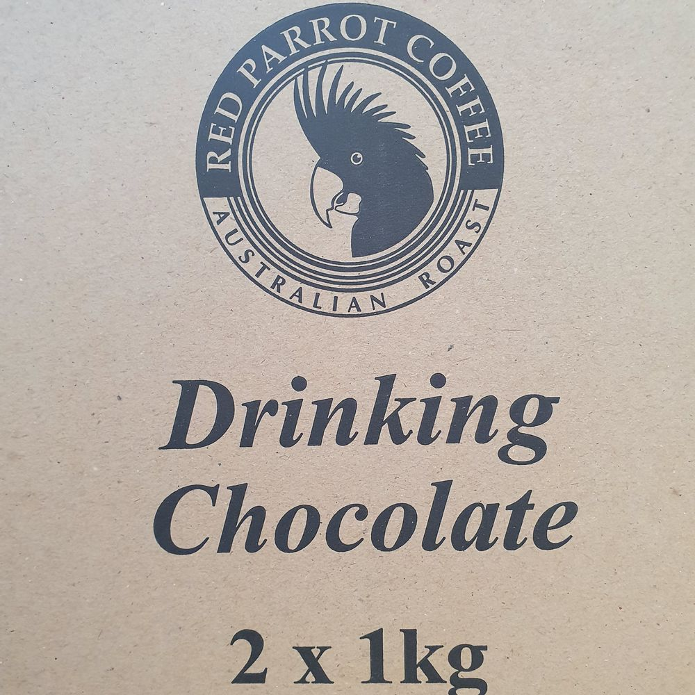 Red Parrot Drinking Chocolate